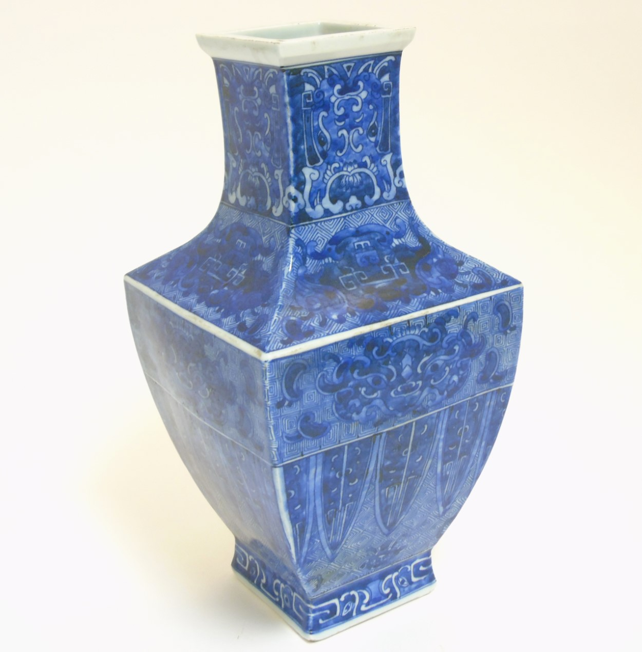 Lot 43 - A Chinese blue and white square section vase, with archaic style decoration ,
