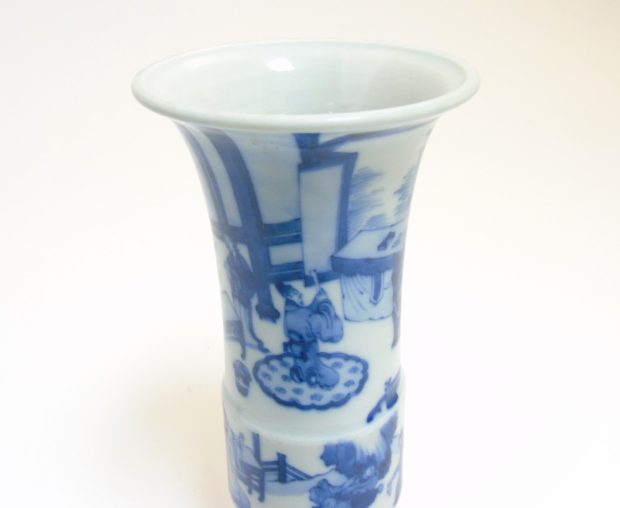 Lot 10 - A Chinese blue and white Gu vase with underglaze blue decoration depicting imperials in a pagoda
