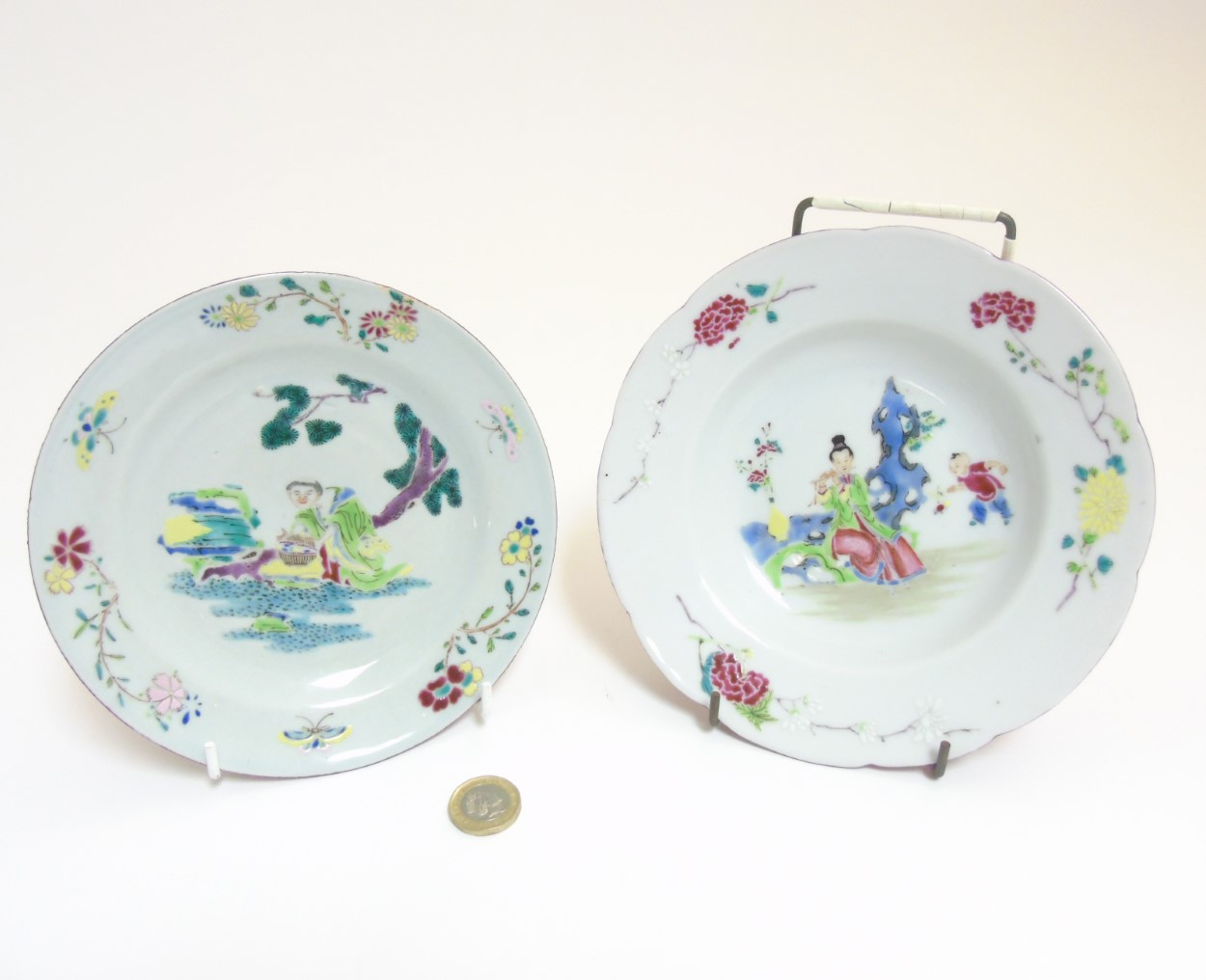 Lot 16 - Two Chinese Famille Rose plates comprising a plate and bowl decorated with iridescent enamels,