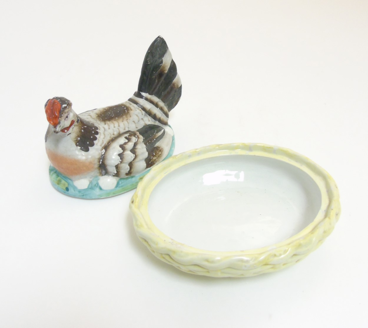 Lot 53 - A 19thC Staffordshire hen on nest tureen with yellow basket,