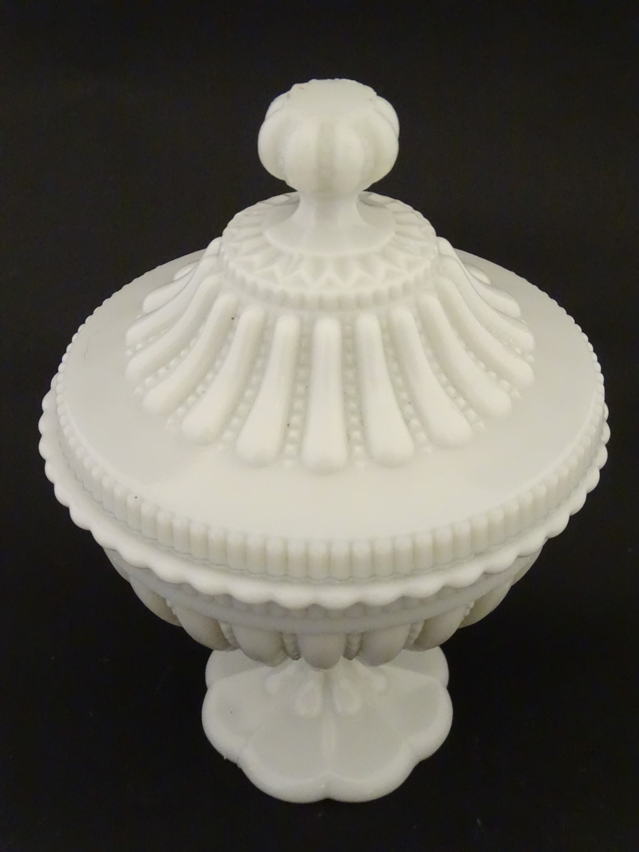Lot 103 - North Country Glass : a pedestal Bon- Bon dish and cover in opaque glass and moulded decoration ,
