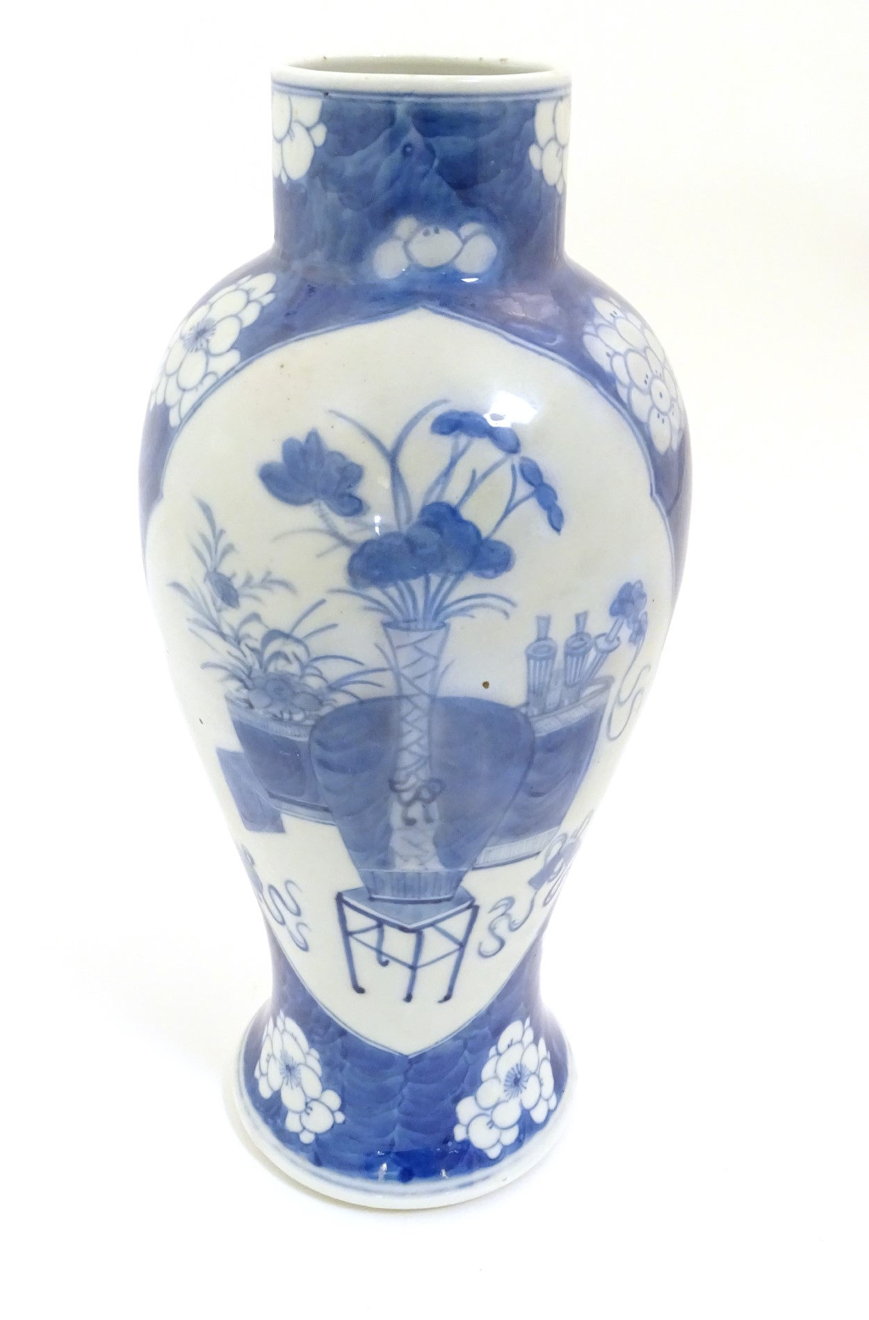 Lot 36 - A Chinese, blue and white baluster vase decorated with prunus flowers,
