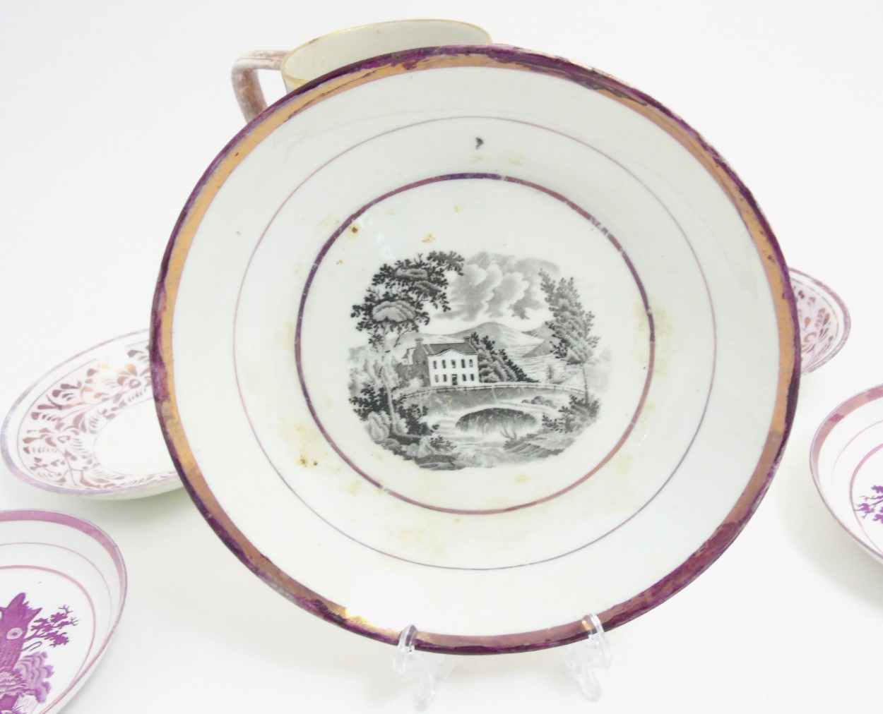 Lot 52 - A quantity of 19thC Sunderland pink lustre items comprising a water jug with marbleized effect