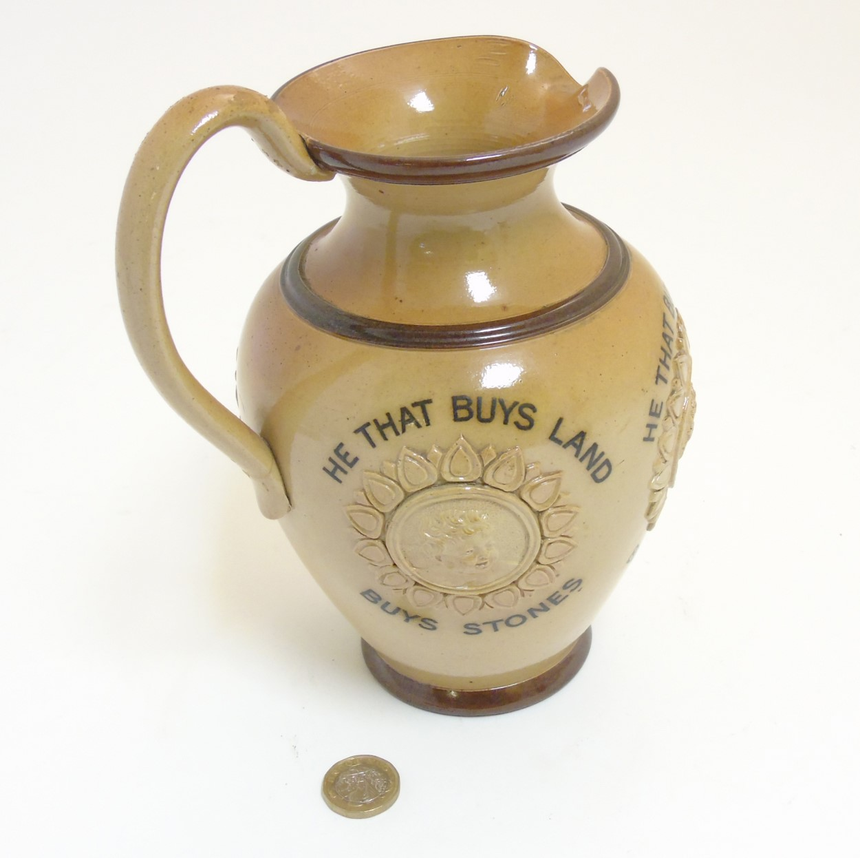 Lot 63 - A late 19thC Doulton Lambeth stoneware 'he that buys' motto jug / pitcher,