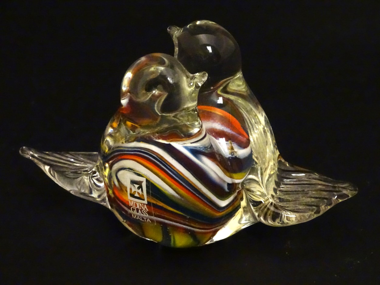 Lot 116 - Mdina Glass , Malta : a pair of entwined Glass Love Birds with stripped decoration ,