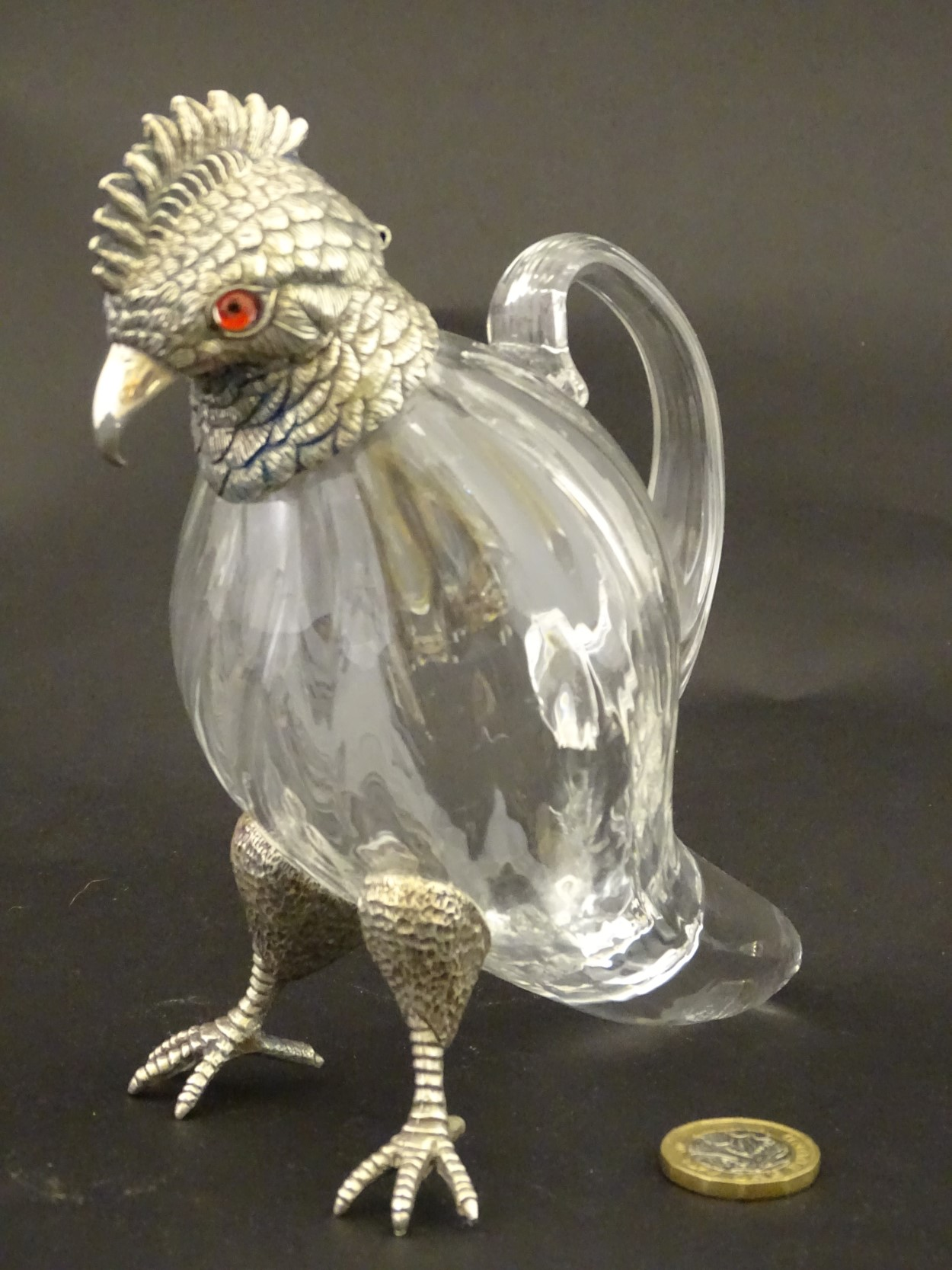 Lot 102 - Glass : a clear glass whiskey Noggin / Chota peg ( whisky water jug ) with silver plate mounts in