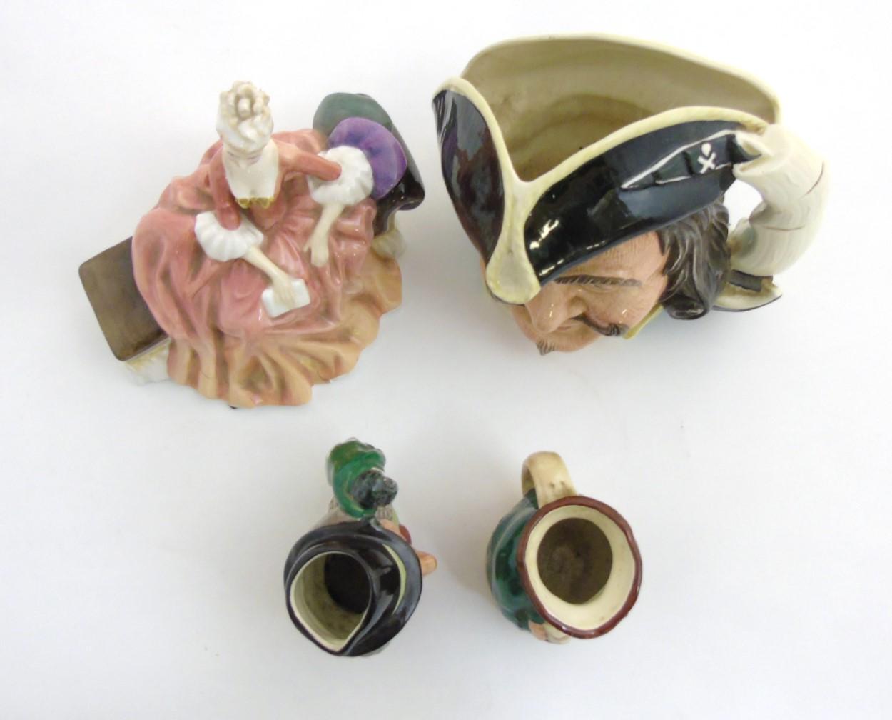 Lot 73 - A quantity of 4 20thC Royal Doulton ceramics comprising three toby jugs including 'Honest Measure',