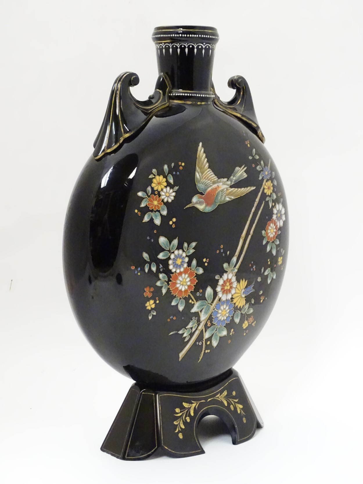 Lot 97 - Glass : a late Victorian black glass Moon Vase with hand applied coloured enamels , in floral ,