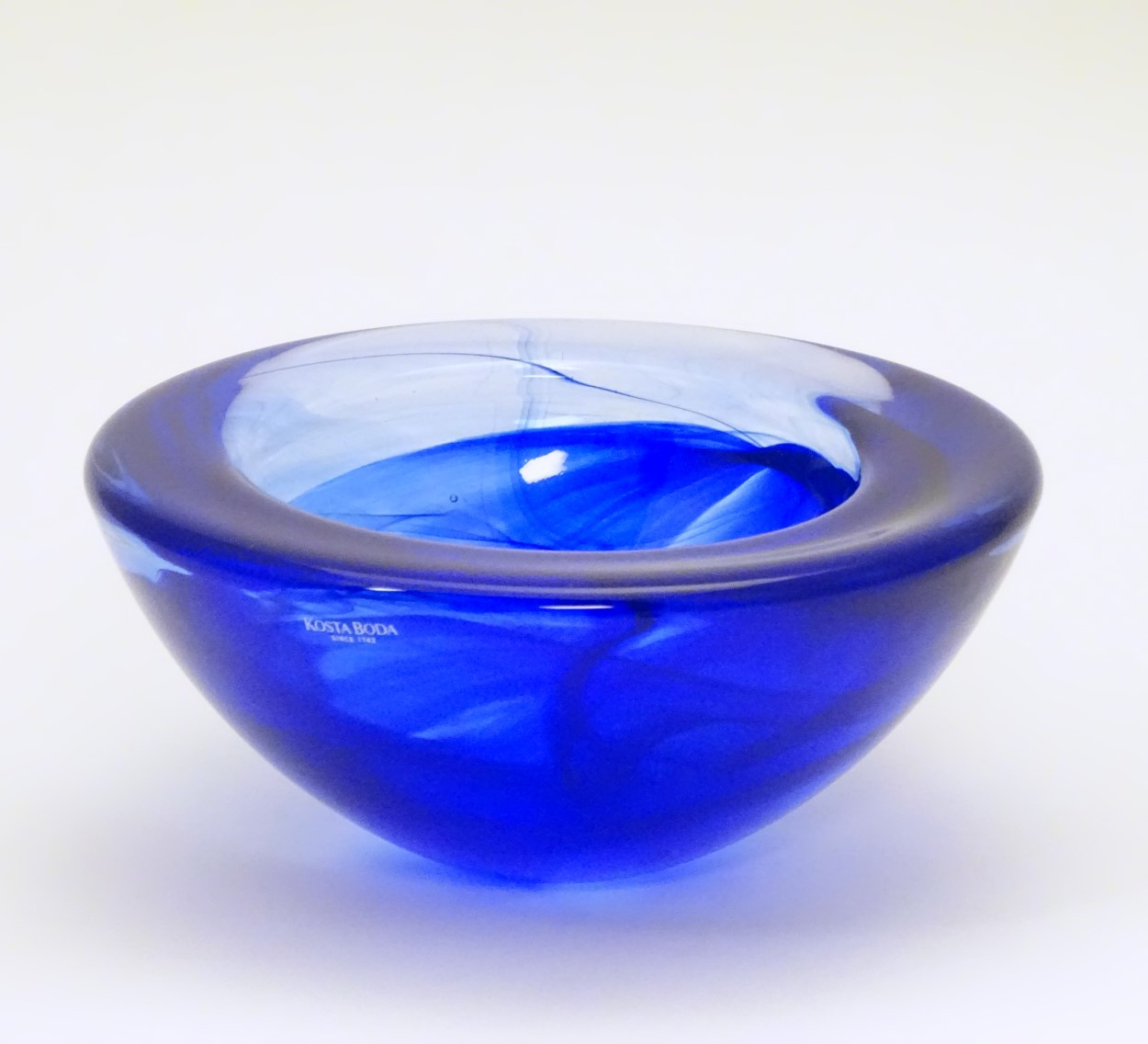 Lot 115 - Swedish Glass : A Kosta Boda cobalt blue swirl bowl ( signed ) designed by Anna Ehrner A Votive