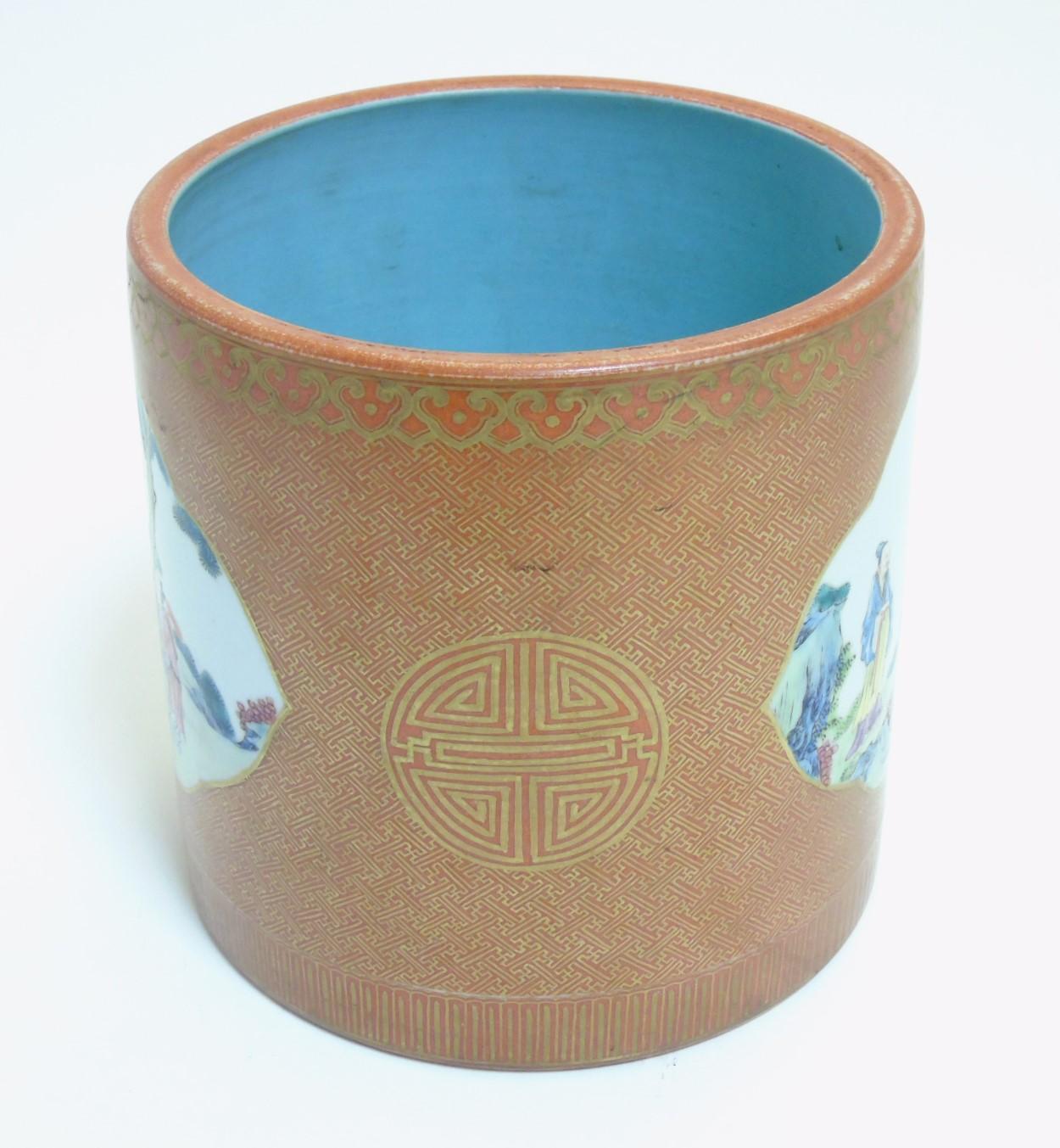 Lot 40 - A Chinese burnt orange brush pot,