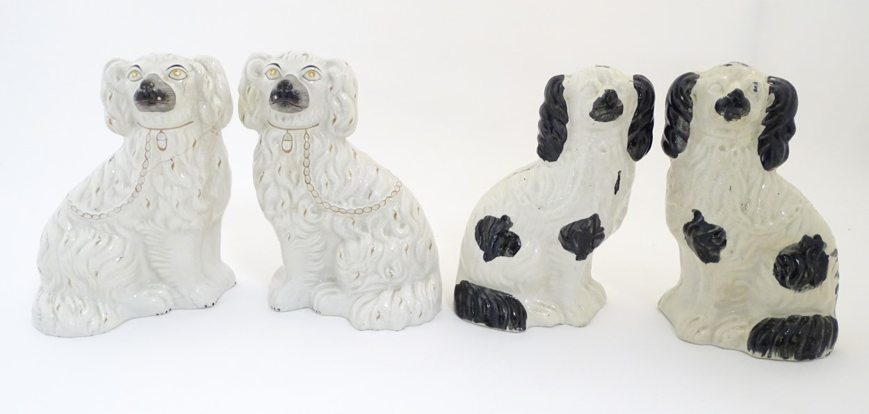 Lot 55 - Two pairs of Staffordshire Victorian seated spaniels.