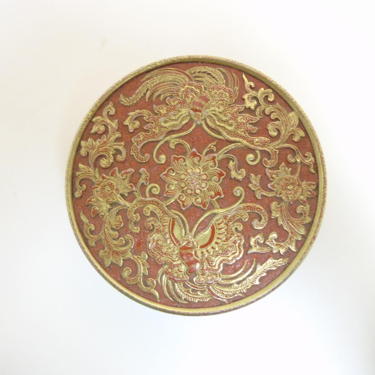 Lot 26 - A Chinese burnt orange circular inkstone / pot,