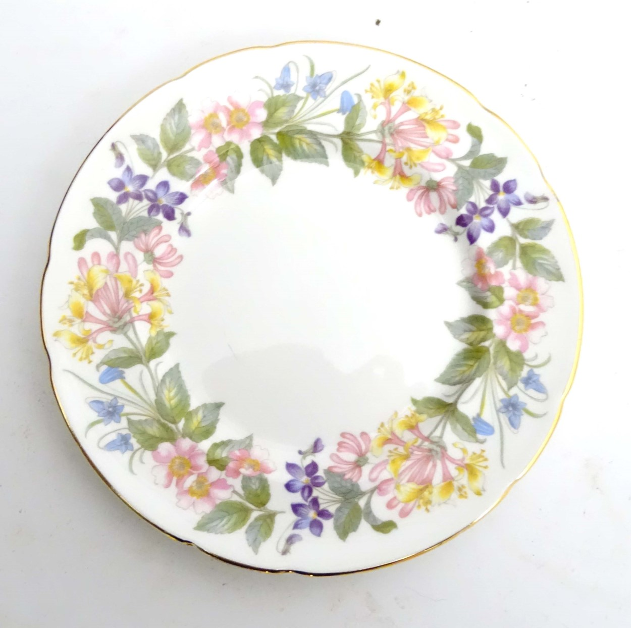 Lot 91 - A quantity of Paragon Country Lane tea wares decorated with a white ground and a colourful floral