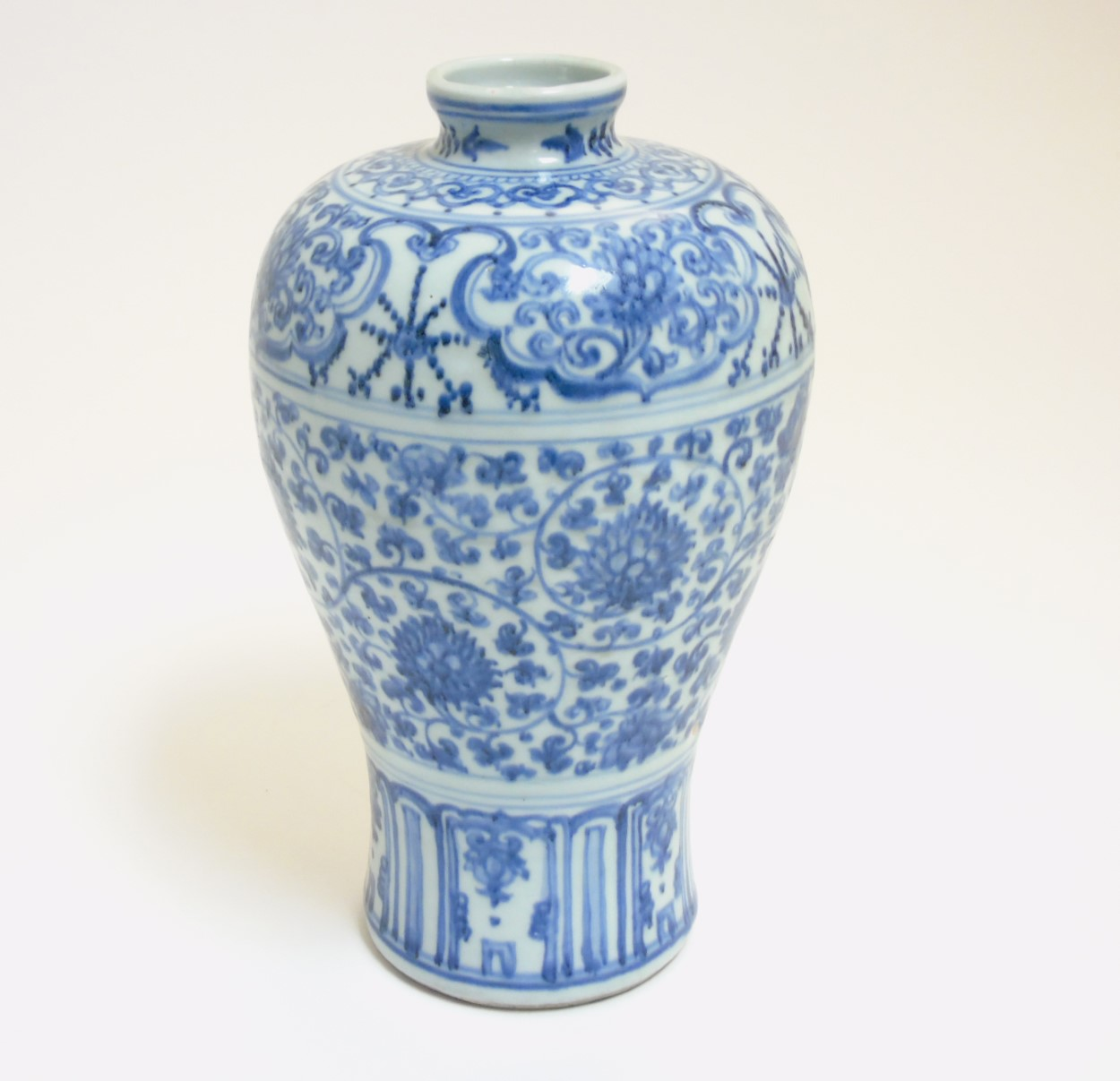 Lot 22 - A Chinese blue and white Meiping vase, with underglaze blue decoration of scrolling lotus,