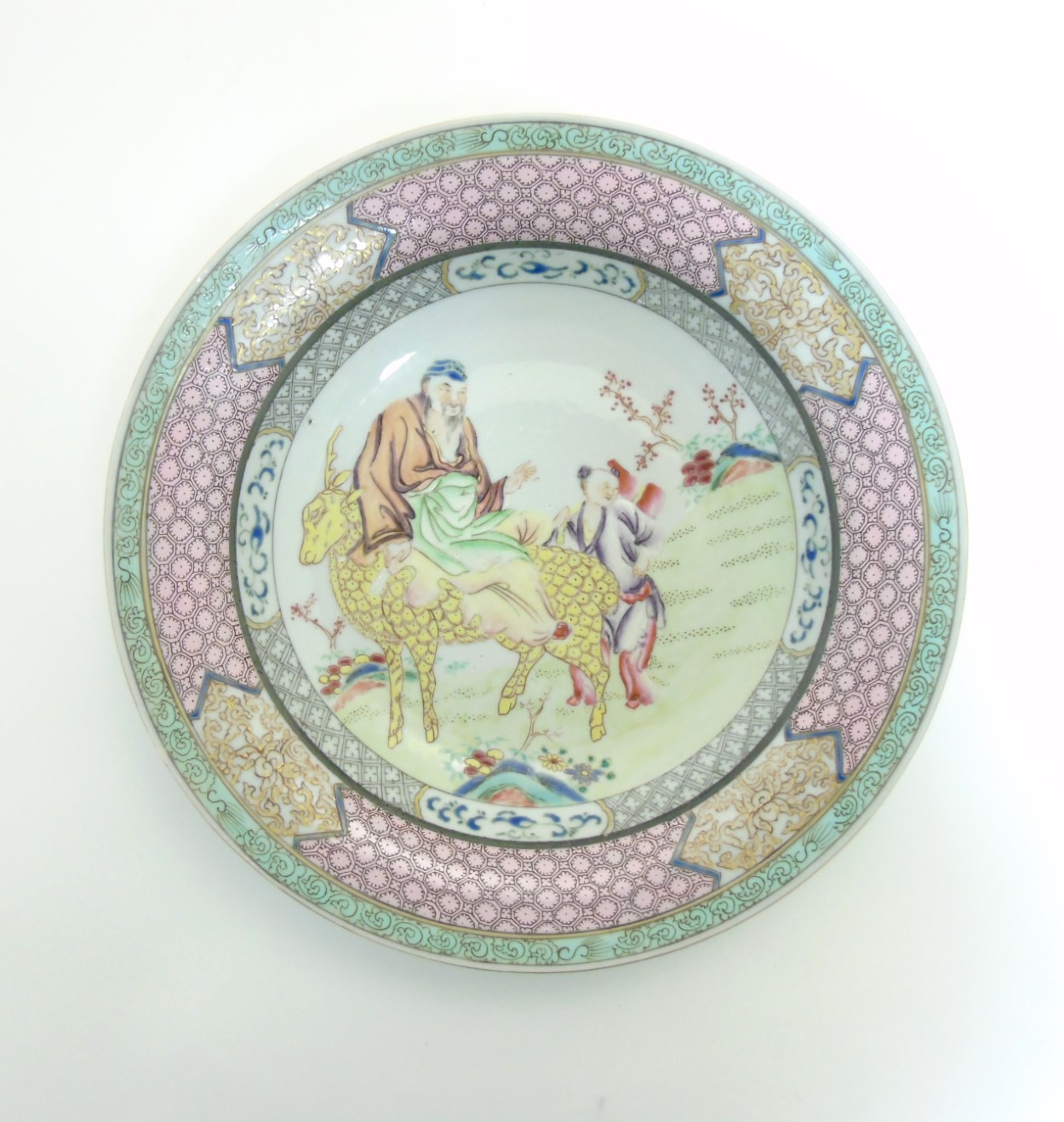 Lot 14 - A Chinese Famille Rose plate with a figure on a yellow coloured deer together with a child to