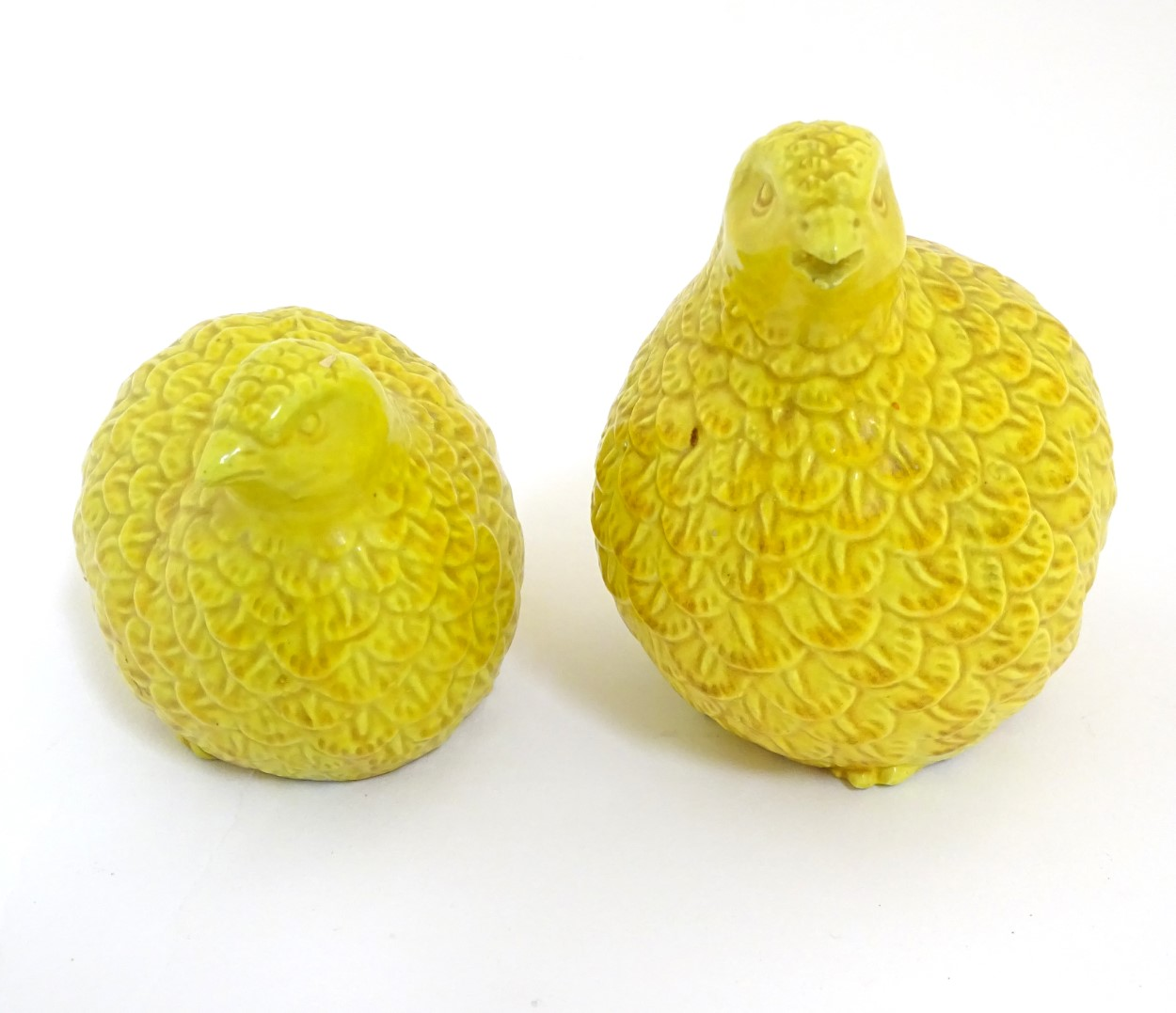 "Lot 34 - Two oriental yellow quail figures. Height of tallest quail: approx. 4 1/2""."