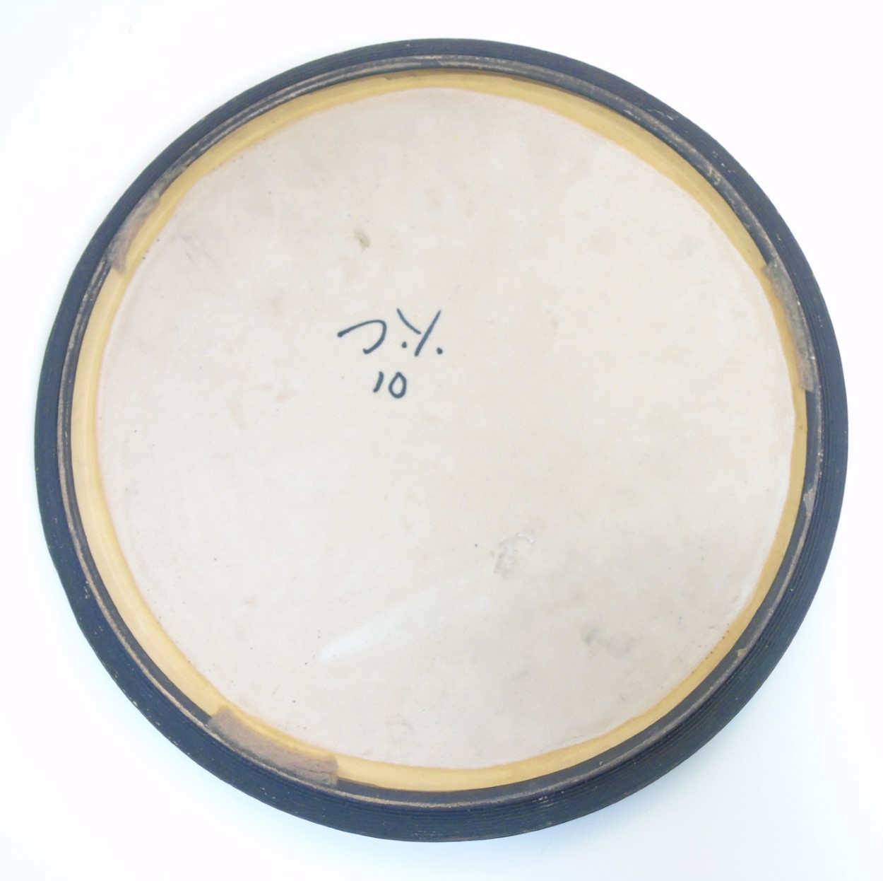 Lot 81 - Scandinavian Studio Pottery: mid 20thC A brown Swedish plate by Yourstone,