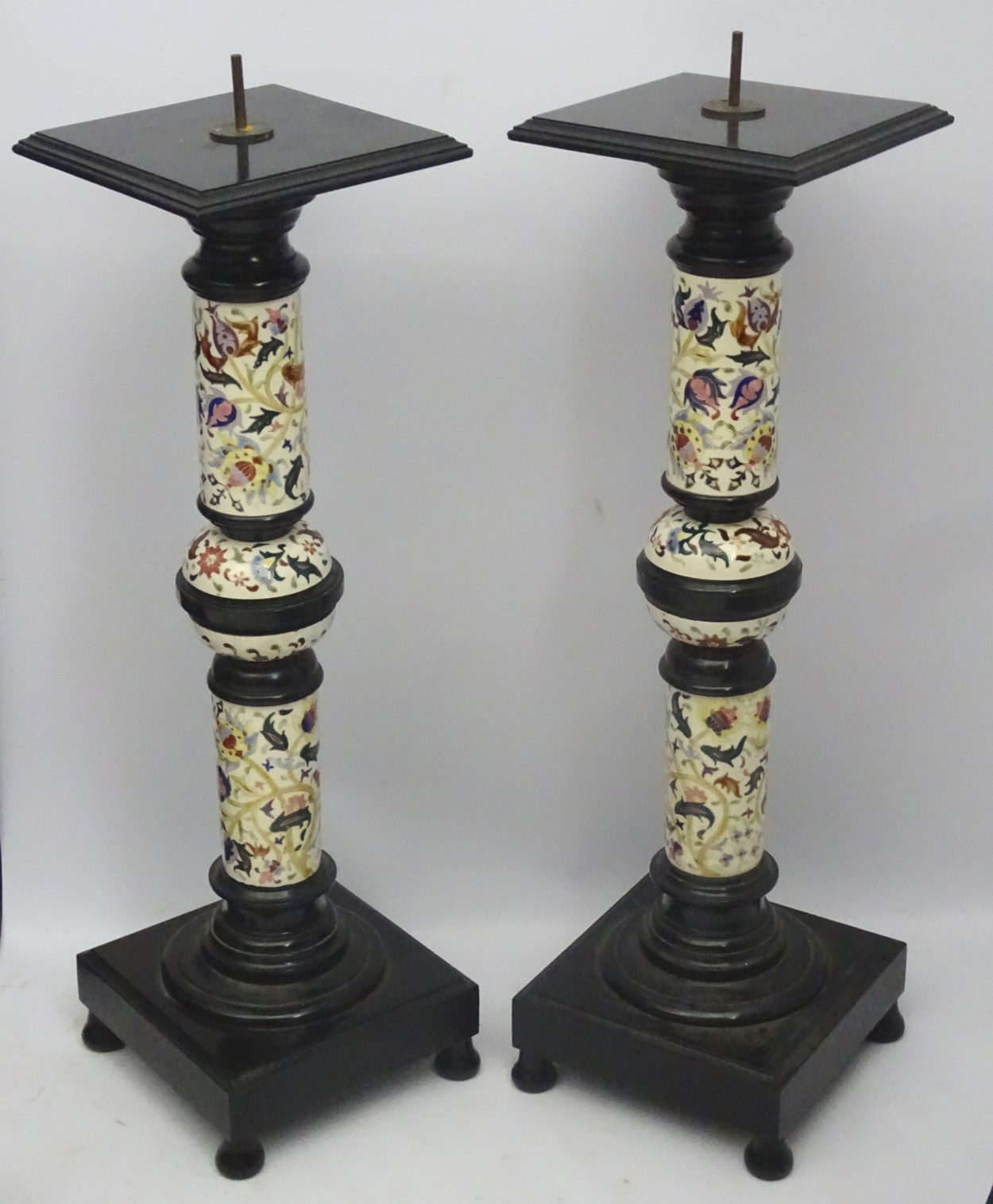 Lot 92 - A pair of early 20thC columns/stands in the Zsolnay faience style,