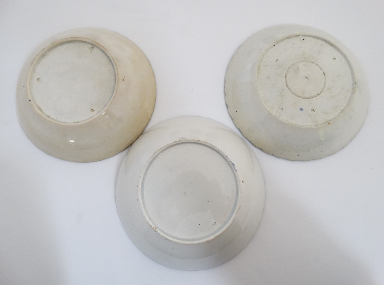 Lot 49 - A set of three early 19thC pearlware transfer printed blue and white teacups / teabowl and saucers