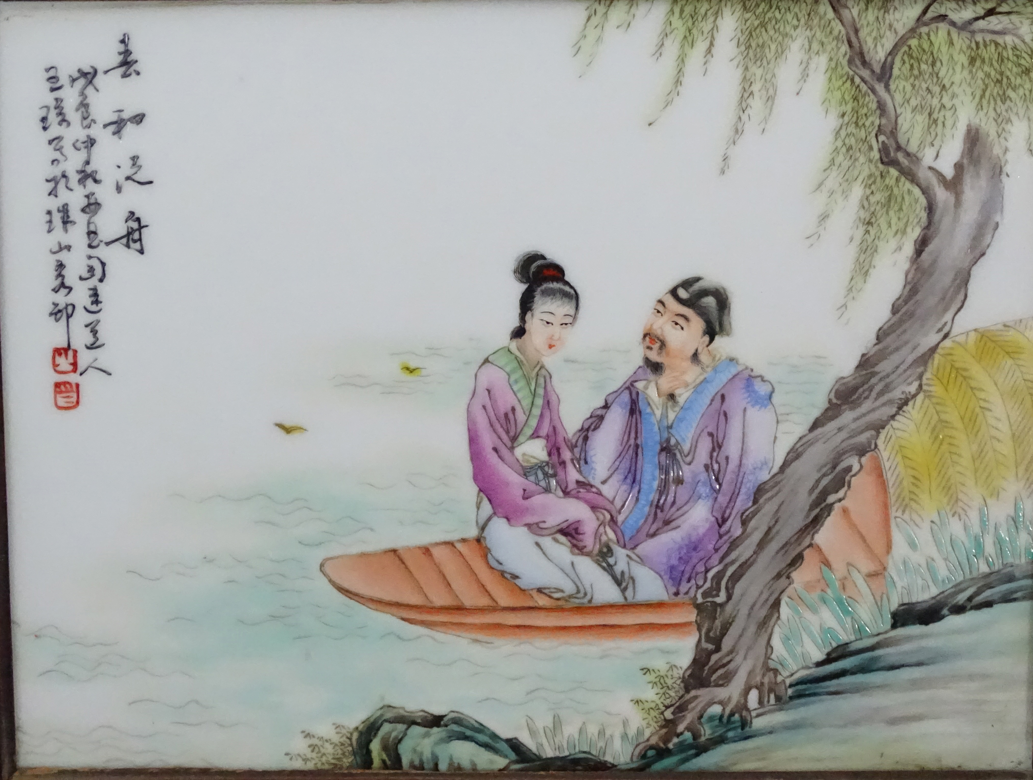 Lot 47 - A Chinese hanging screen formed of two famille rose ceramic panels in wooden frame,