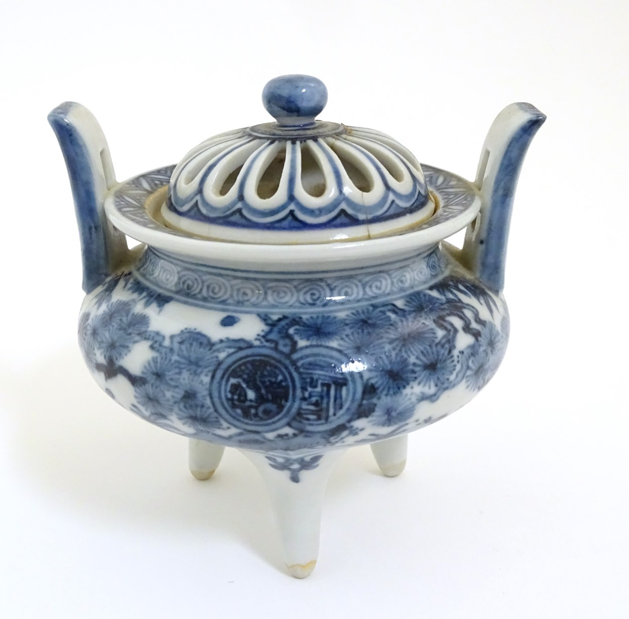Lot 24 - A Chinese blue and white three legged, two handled censer with pierced cover,