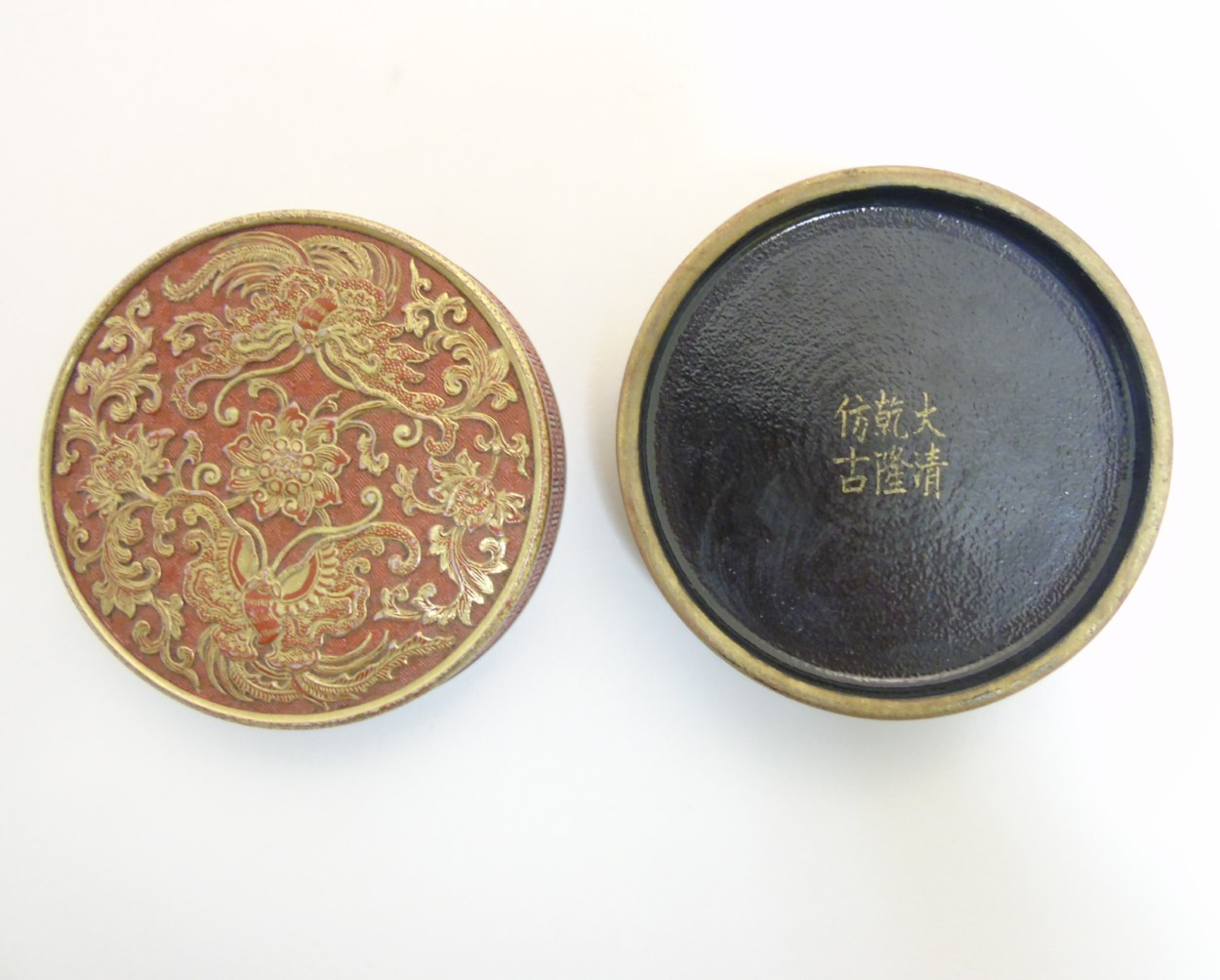Lot 26 - A Chinese burnt orange circular inkstone / pot,