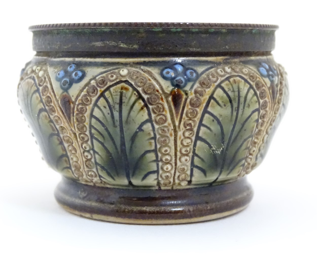 Lot 66 - A later 19th/early 20thC small stoneware pot/table salt, with metal rim. In the manner of Doulton.