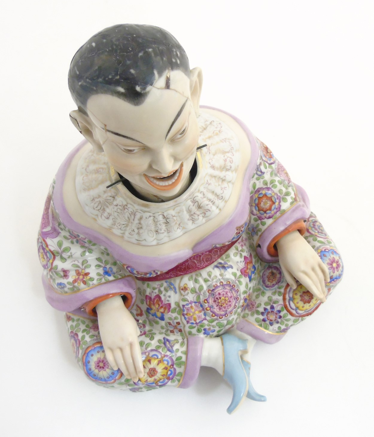Lot 51 - A Schierholz porcelain figure of a Chinese / Oriental man with nodding head and articulate hands,