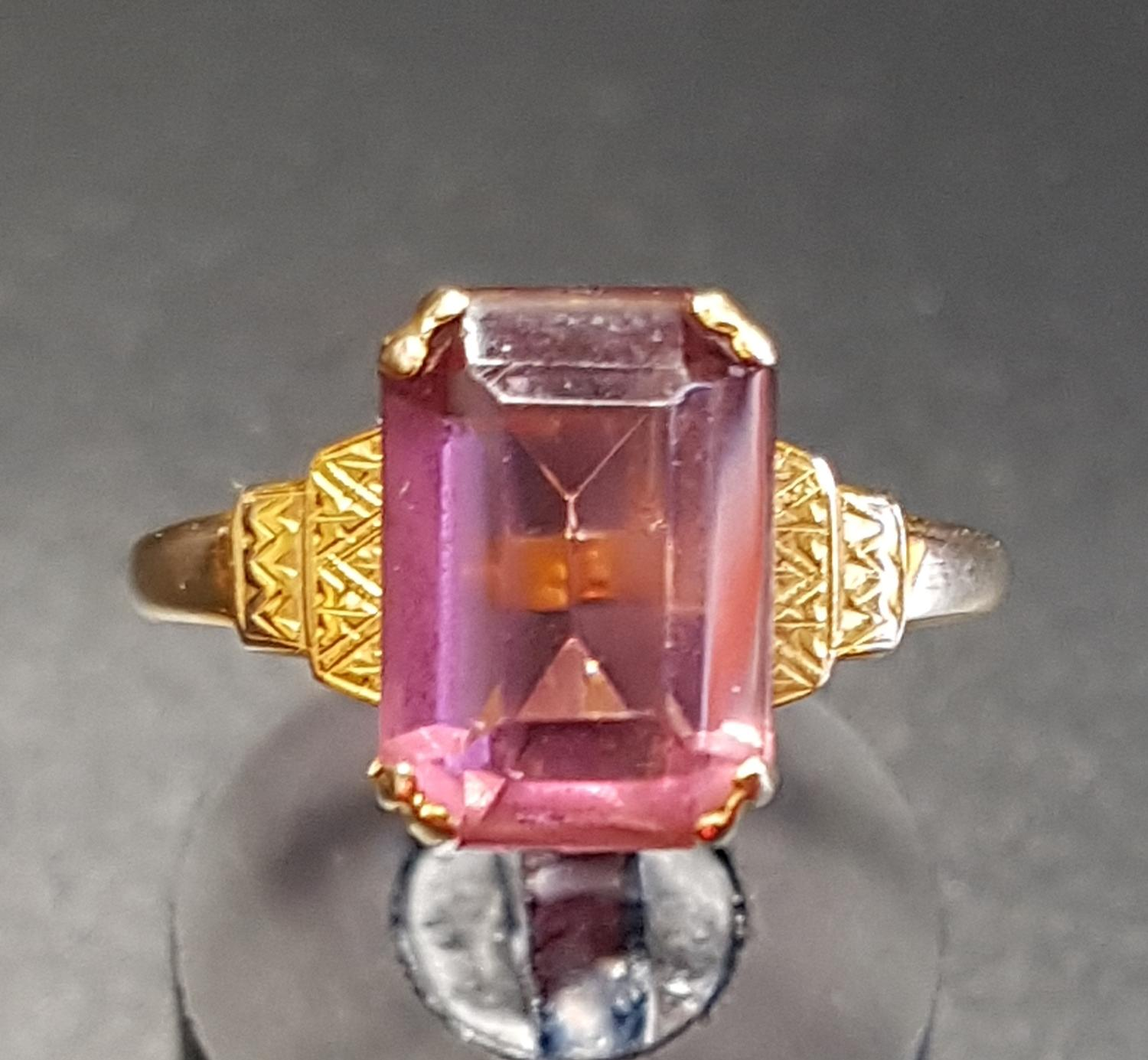 Lot 20 - PINK GEM SET SINGLE STONE RING on nine carat gold shank with stepped shoulders, ring size P