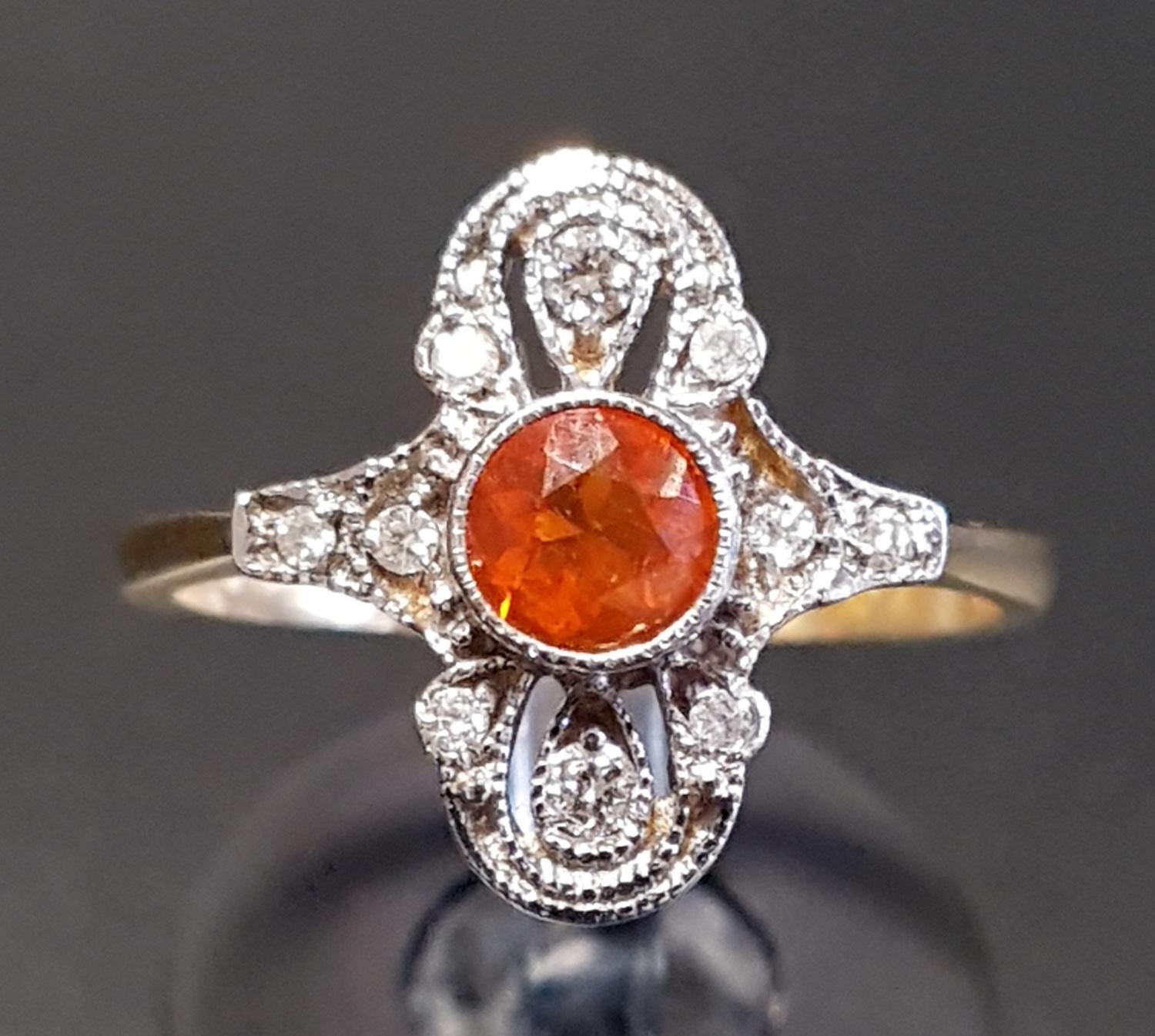 Lot 7 - ATTRACTIVE ART DECO STYLE FIRE OPAL AND DIAMOND PLAQUE RING the central round cut fire opal in multi