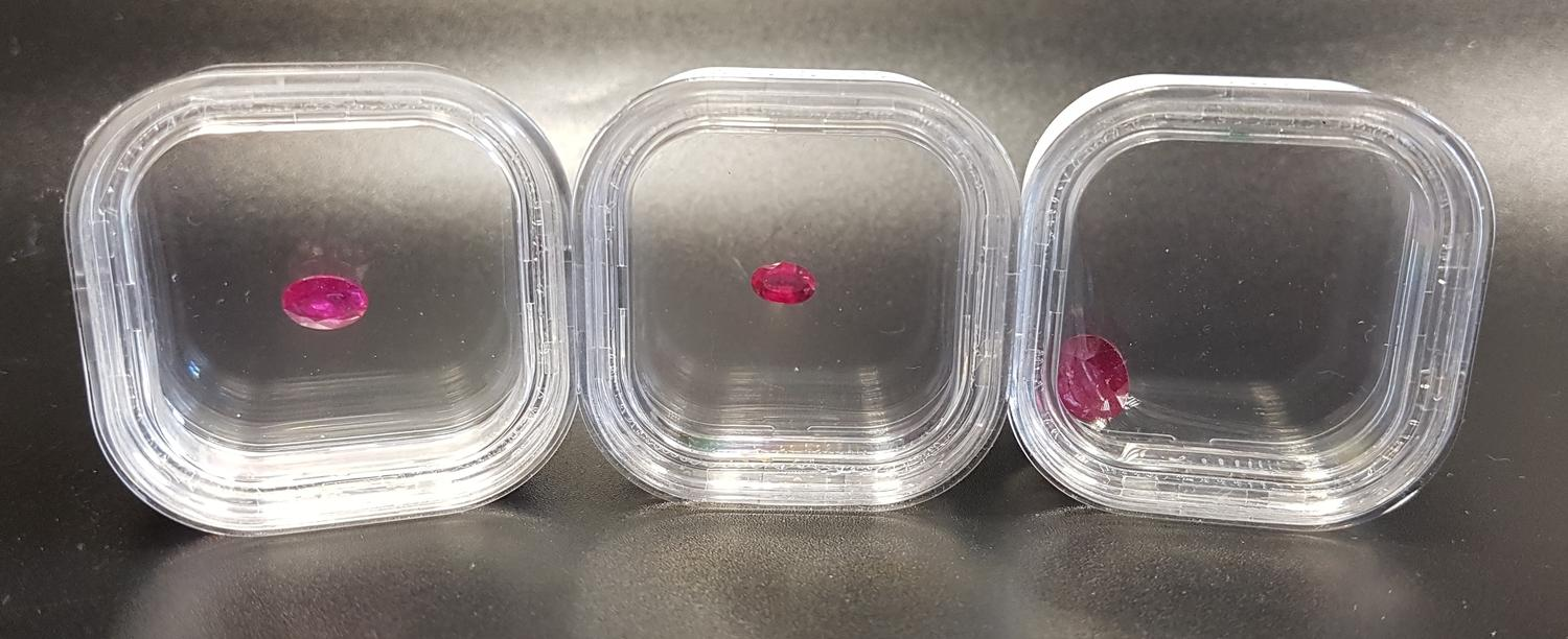 Lot 54 - THREE LOOSE CERTIFIED RUBIES comprising an oval cut Thai Ruby weighing 2.85cts, an oval cut Malagasy