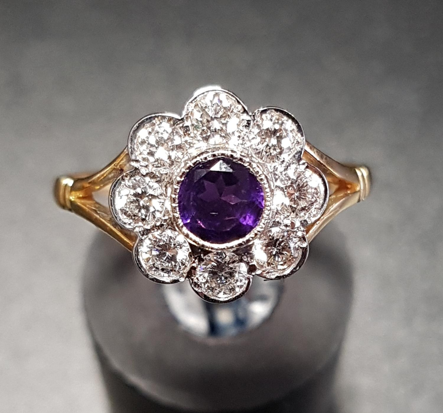 Lot 28 - AMETHYST AND DIAMOND CLUSTER RING the central amethyst in eight diamond surround, the diamonds