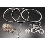 SELECTION OF SILVER JEWELLERY including three bangles, silver pendants and chains, and a Thomas Sabo