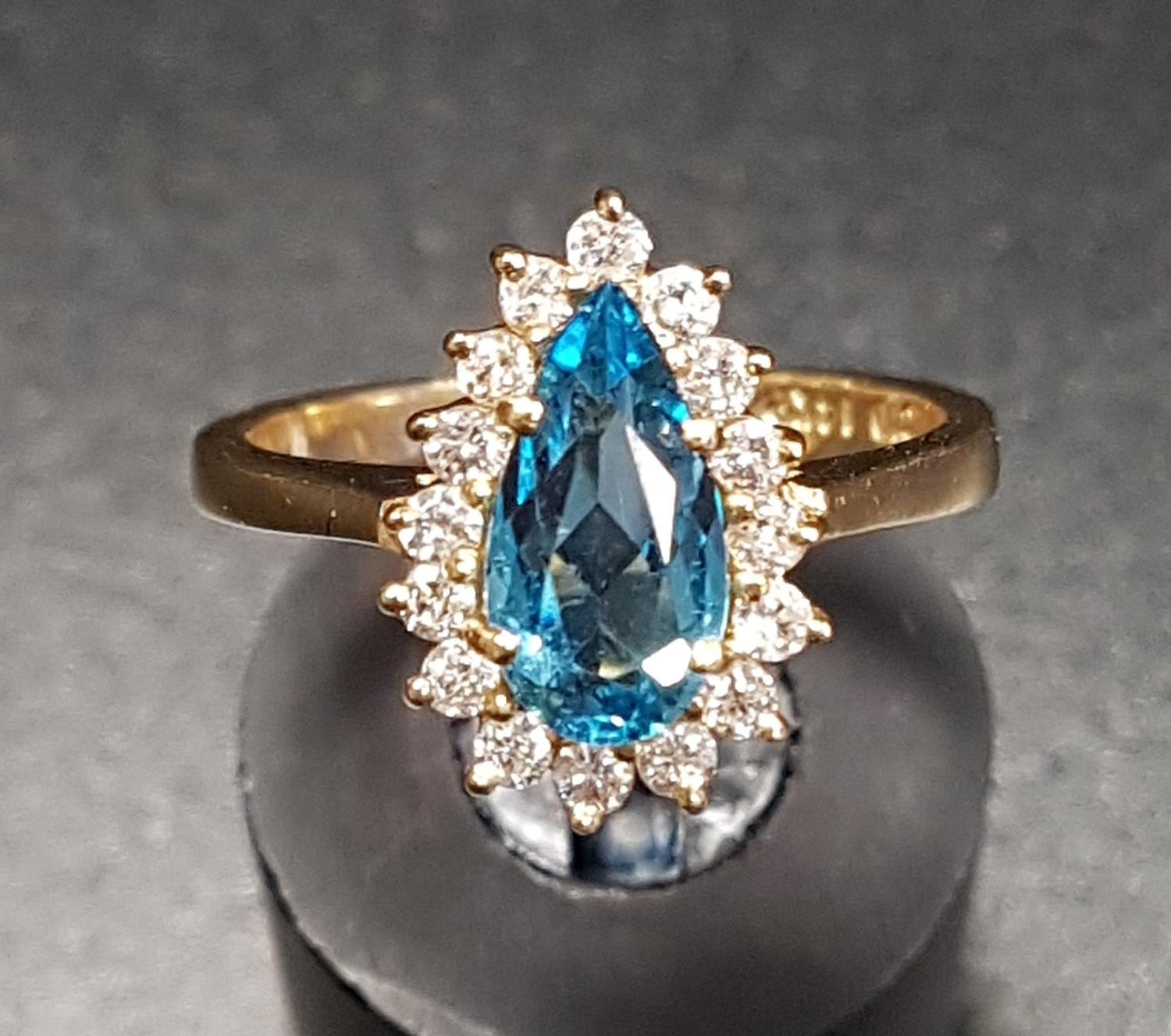 Lot 48 - BLUE TOPAZ AND DIAMOND DRESS RING the central blue topaz approximately 1ct in sixteen diamond