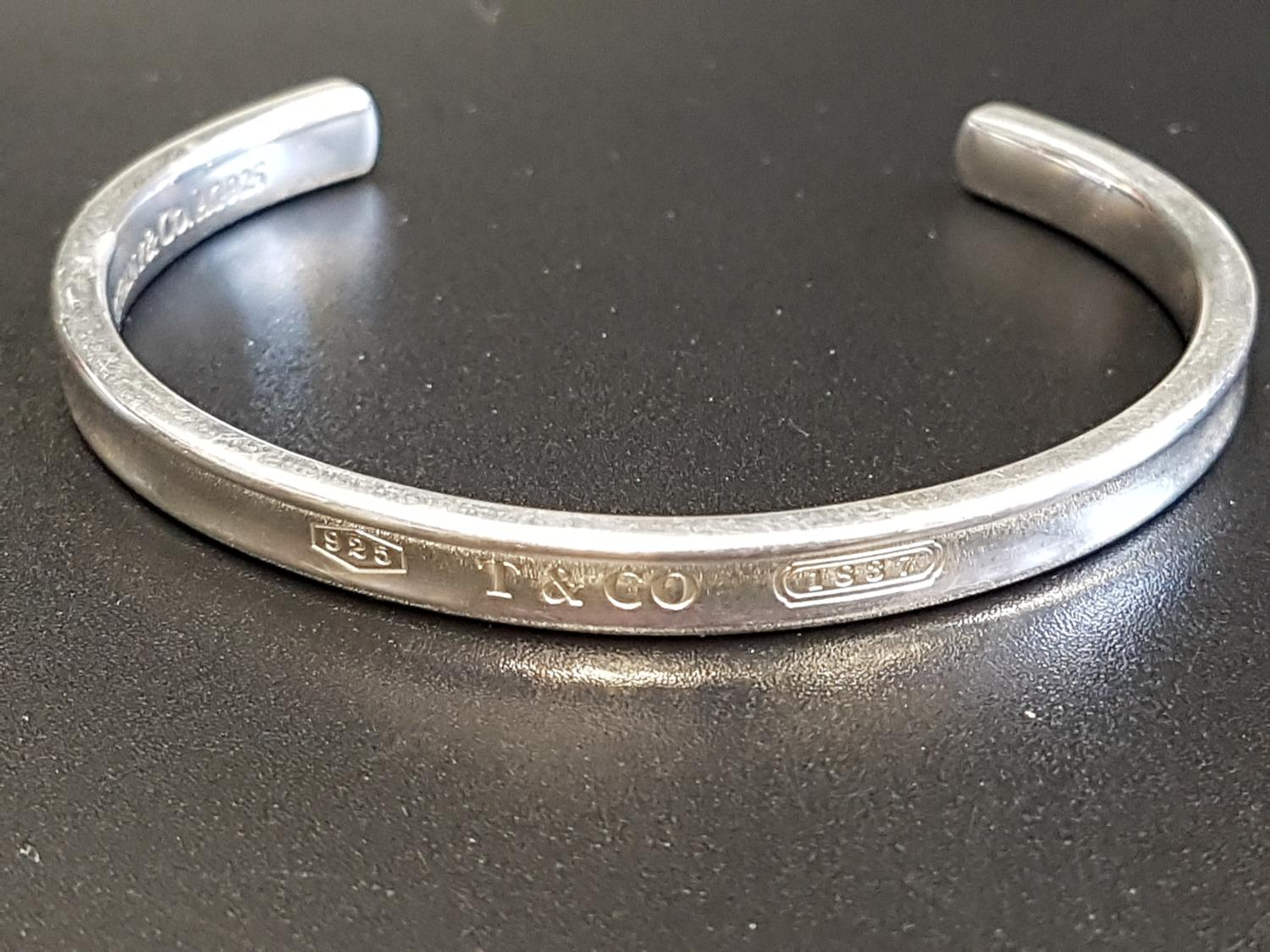 Lot 6 - TIFFANY & CO. SILVER 'TIFFANY 1837' CUFF BANGLE inscribed with 925, T&CO, and 1837 (the year Tiffany
