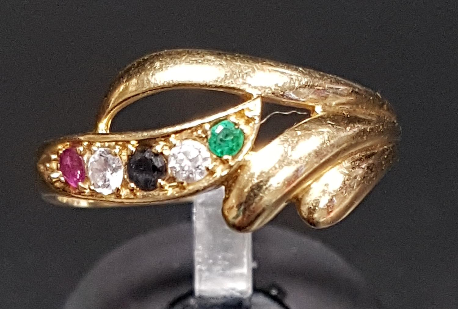 Lot 12 - ATTRACTIVE SAPPHIRE, EMERALD, RUBY AND CZ DRESS RING the multi gemstones in decorative scroll