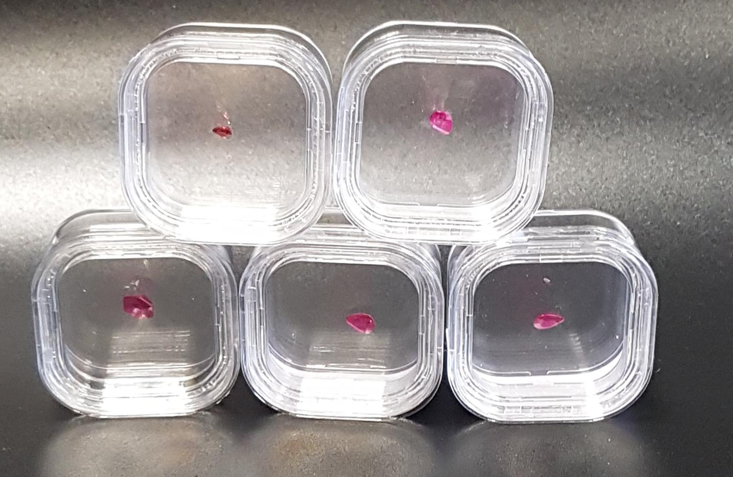 Lot 55 - FIVE LOOSE CERTIFIED RUBIES comprising a pear cut Montepuez Ruby weighing 0.6cts, a pear cut Burmese