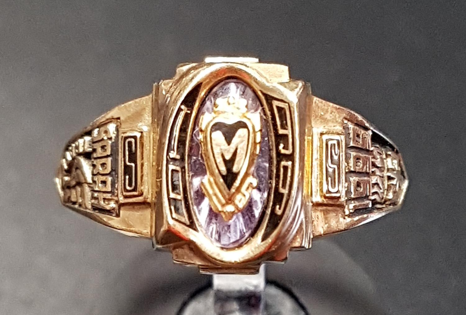 Lot 15 - TEN CARAT GOLD COLLEGE RING BY JOSTENS the central M in heart shaped cartouche, flanked by relief