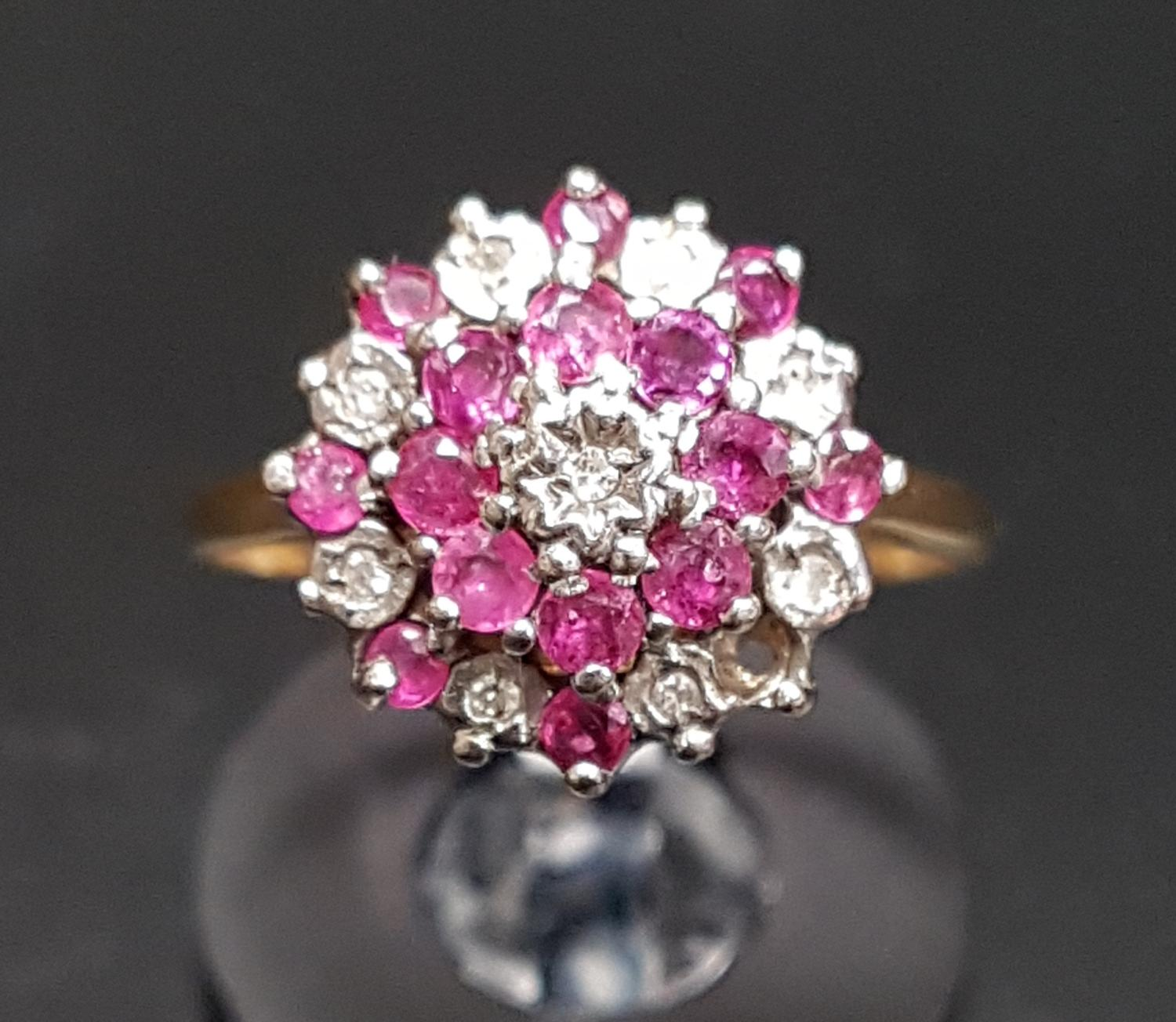 Lot 50 - RUBY AND DIAMOND CLUSTER RING in stepped setting and on nine carat gold shank, ring size L-M