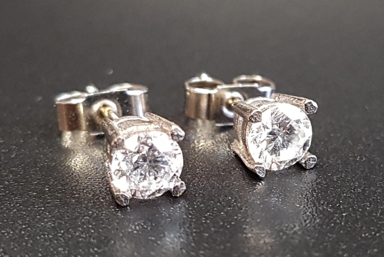 Lot 39 - PAIR OF DIAMOND STUD EARRINGS the round brilliant cut diamonds totalling approximately 0.7cts, in