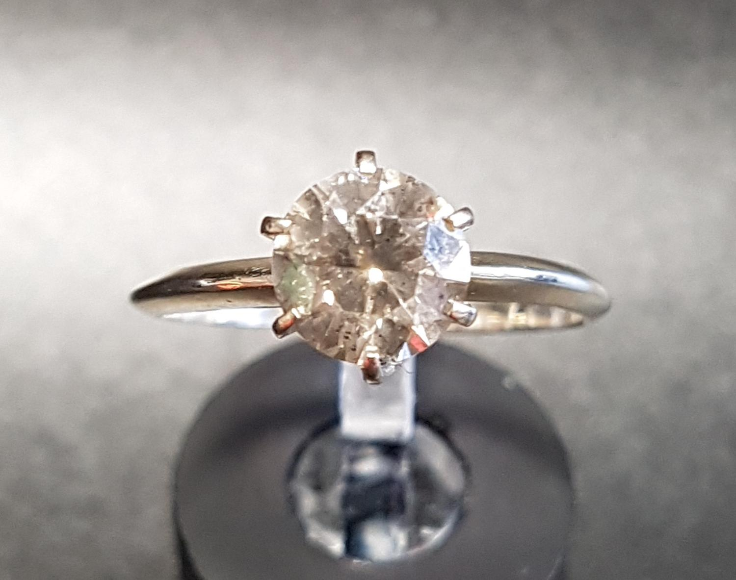 Lot 37 - DIAMOND SOLITAIRE RING the round brilliant cut diamond approximately 1.5cts, on fourteen carat