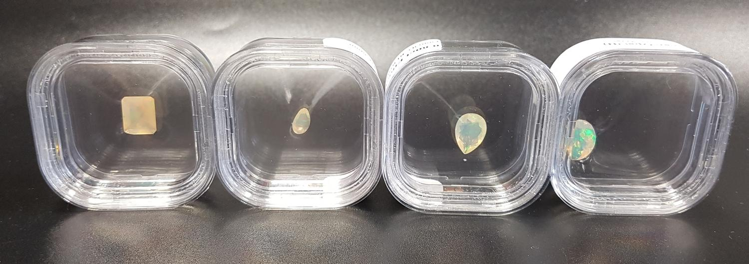 Lot 52 - FOUR LOOSE CERTIFIED ETHIOPIAN OPALS comprising a pear cut weighing 0.8cts, a pear cut weighing 0.