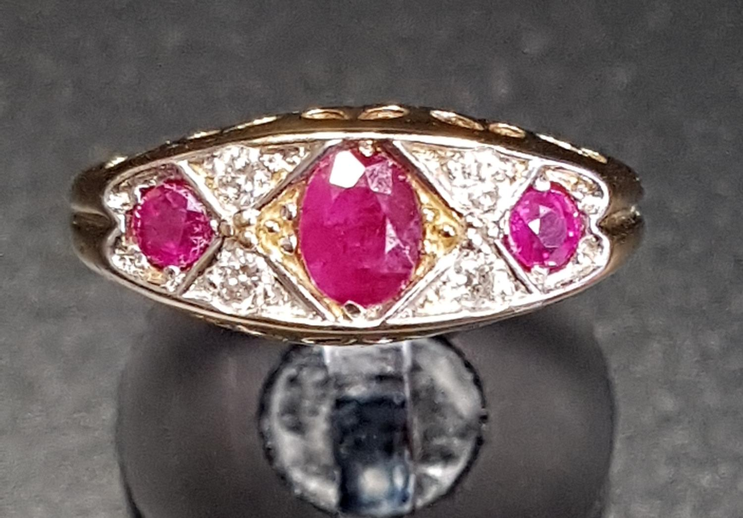 Lot 44 - RUBY AND DIAMOND RING the three graduated rubies separated by small diamonds, on eighteen carat gold