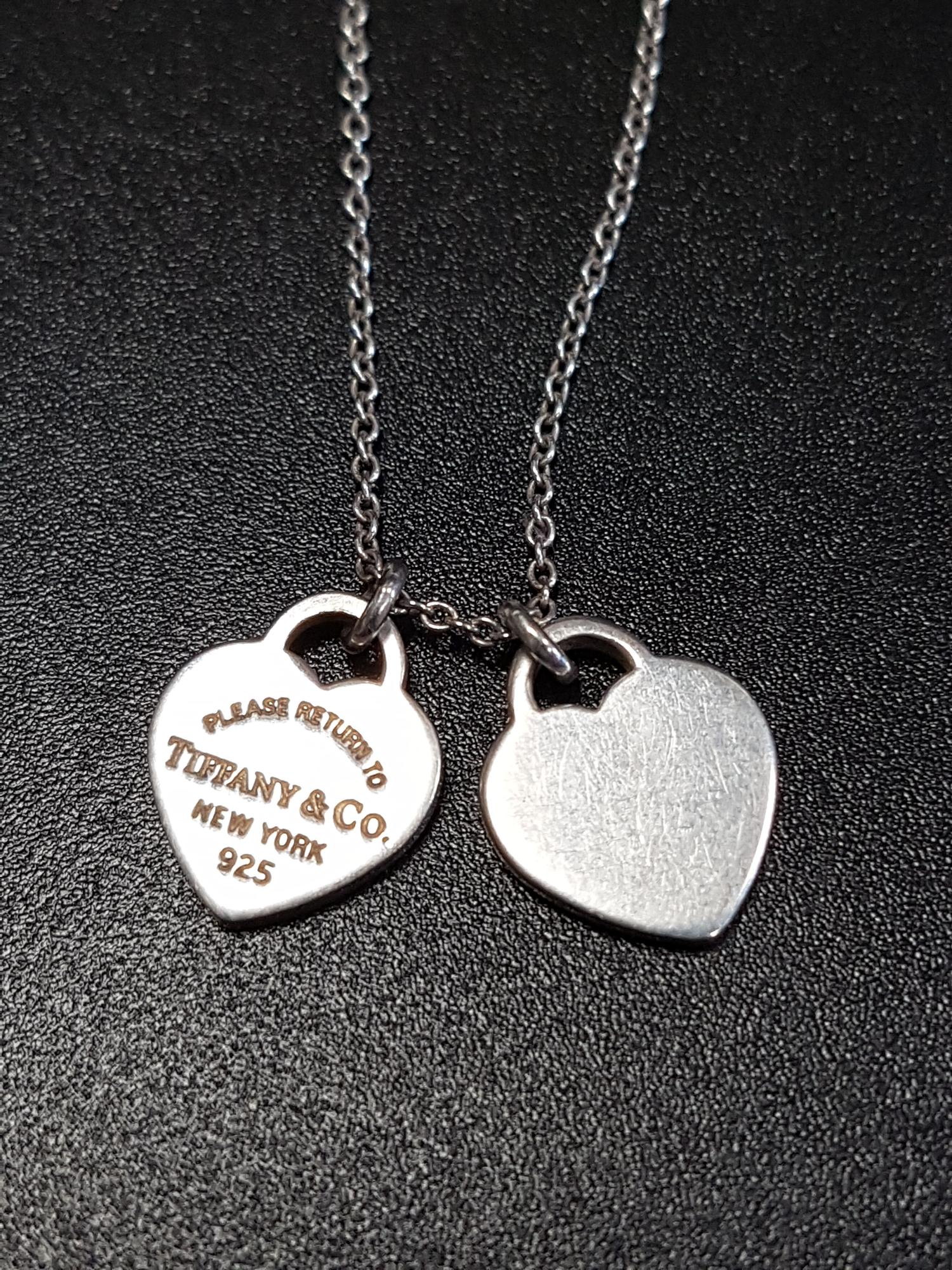 Lot 51 - TIFFANY & CO. 'RETURN TO TIFFANY' MINI DOUBLE HEART TAG SILVER PENDANT on silver Tiffany chain,