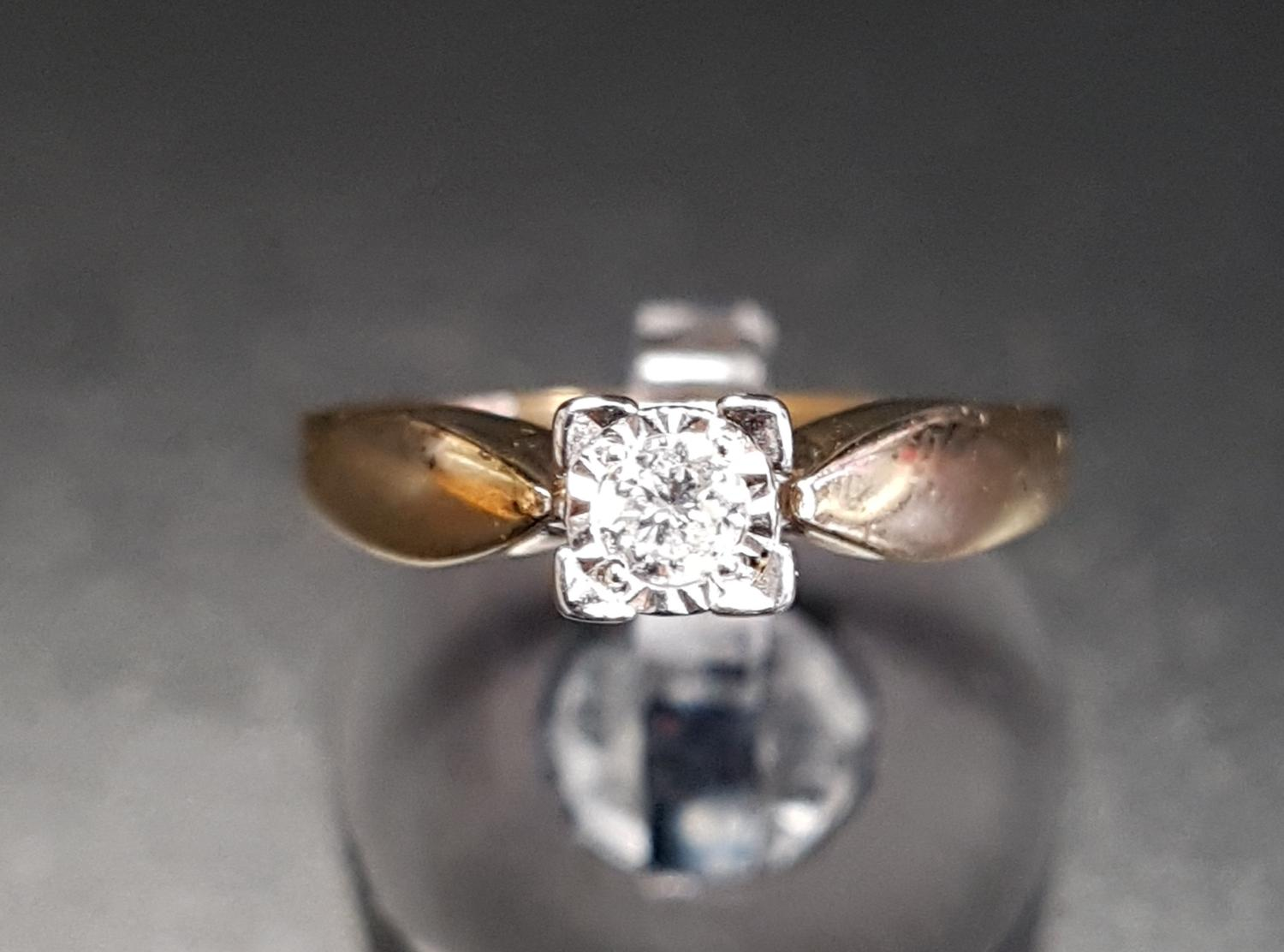 Lot 14 - DIAMOND SOLITAIRE RING the illusion set round brilliant cut diamond approximately 0.12cts, on nine