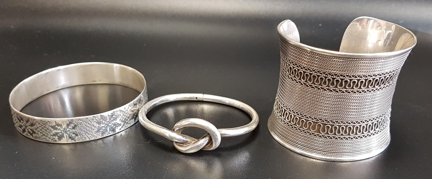 Lot 4 - LARGE SILVER CUFF BANGLE with rope twist detail; together with two further silver bangles, one