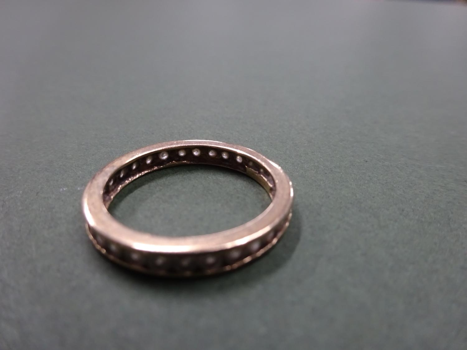 Lot 4 - 9ct gold full eternity band with white stones set within two bands, total weight 2.4g