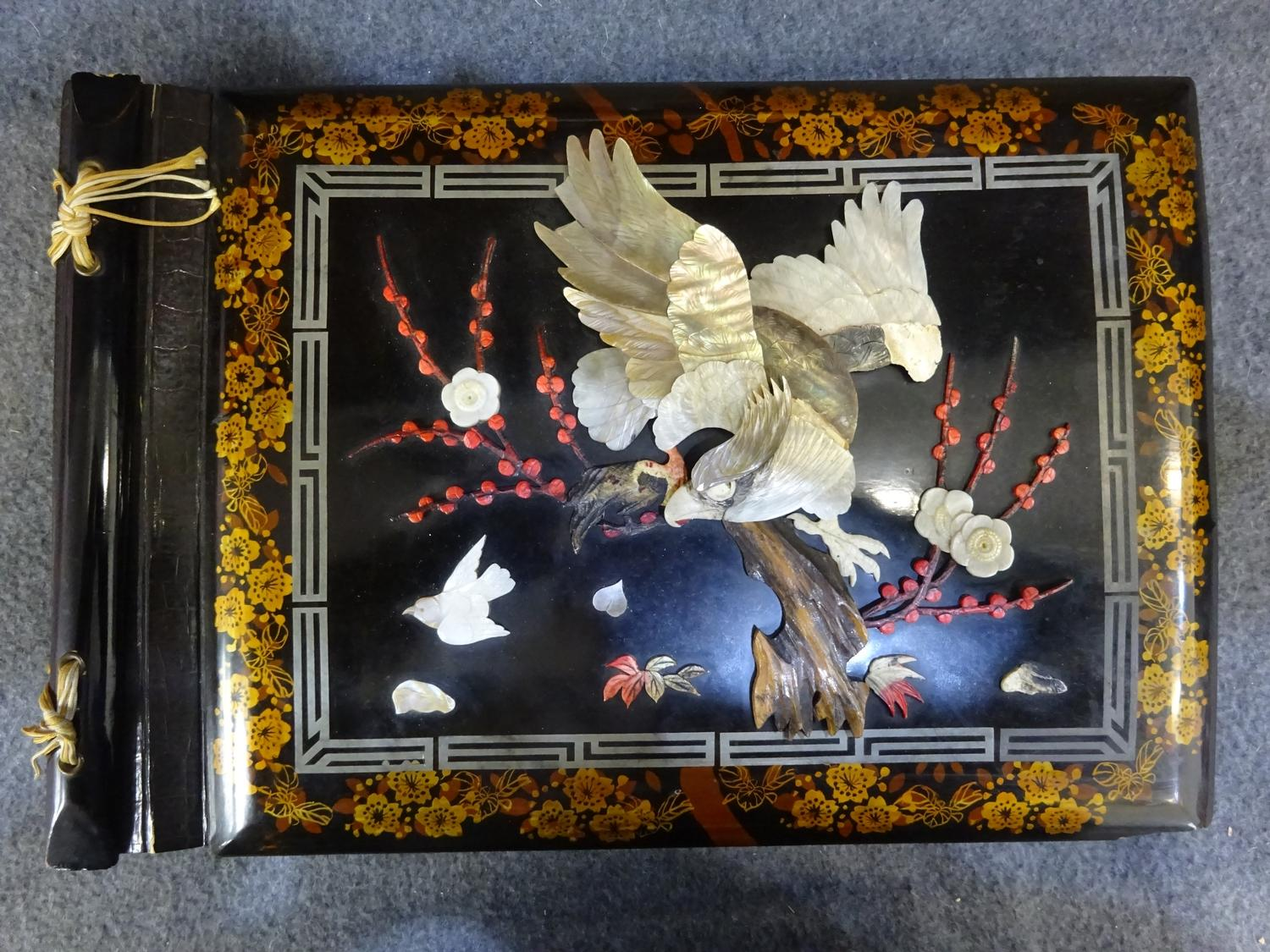Lot 51 - (V) Paper mache 1940s oriental photo album w/ abalone eagle on cover. Contains military photographs