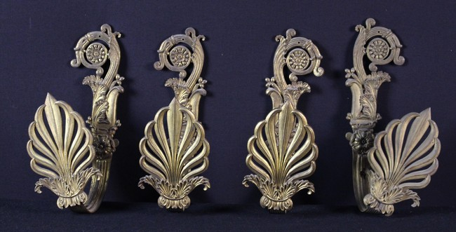 Lot 26 - A Set of Four French Empire Gilt Metal Tie Backs.