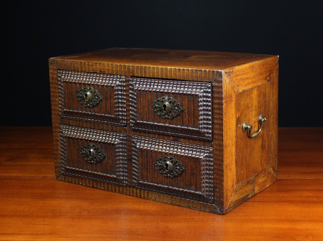 Lot 50 - A 17th Century Portuguese Rosewood Table Cabinet housing two small drawers over one long drawer